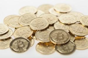 Geprägte Bitcoin-Münzen, deren Wert aber nur virtuell existiert - Foto: ulifunke.com / bitcoin.de